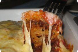 Italiaanse recepten gepaneerde schnitzel in tomatensaus van Italian Residence